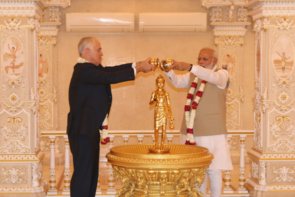 Offering abhishek of Nilkanth Varni for prayers for world peace at Swaminarayan Akshardham, New Delhi.