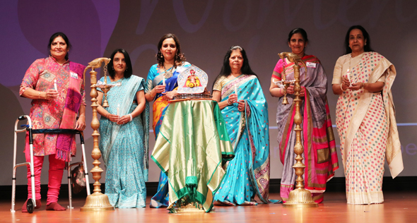 The conference commences with the lighting of the divo by the keynote speaker and special guests. From left: Jyotsna Patel, Dr. Nita Gandhi, Asha Dhume (Keynote Speaker), Dr. Heena Thakkar, Sushma Pallod, Sushila Agrawal.