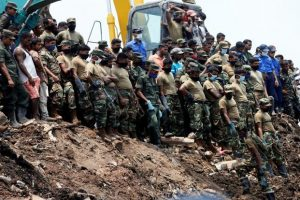 On President Maithripala Sirisena's directive, hundreds of military personnel have been deployed to rescue the slum dwellers adjacent to the 300-foot garbage dump. Photo: Reuters