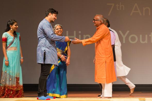 Ashwin DaveBAPS Mandir representative passed on the baton to host the HGH Youth Awards function next year to ISKCON Mandir's Gaura Klein and Dr. Hansa Madley.