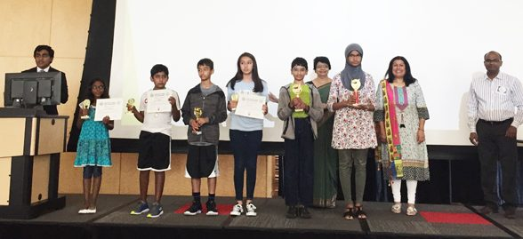 NSF children proudly displaying their hard-earned trophies (with Falguni Gandhi, President, ICC and Parul Fernandez)