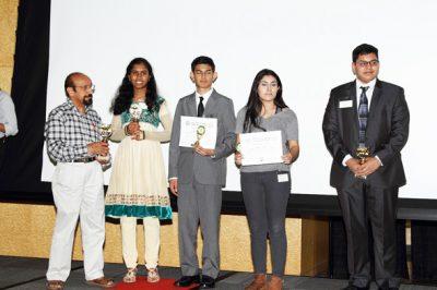 Children receiving awards from Mahesh Wadhwa