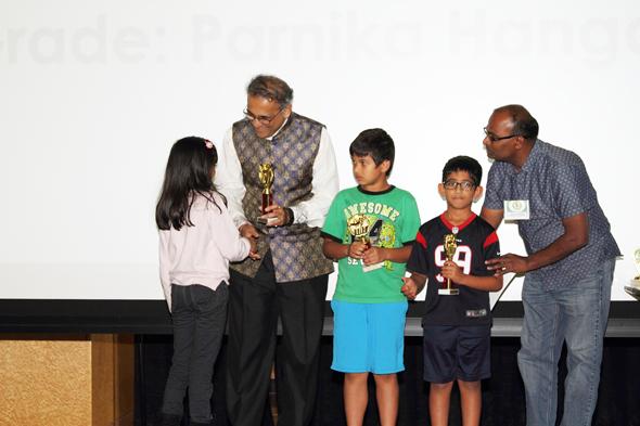 Children receiving awards from Swapan Dhairyawan