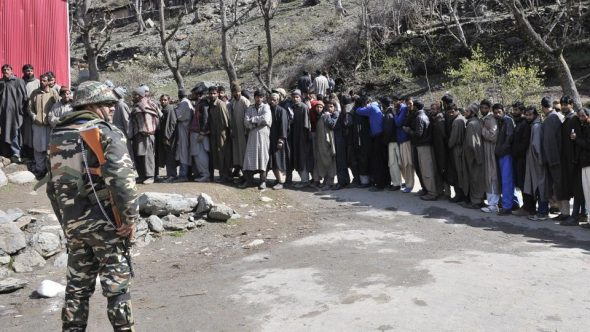 Members of Gujjar community stand in line as they wait their turn to cast their vote outside a polling station in Baba Nagri area in Kangan, some 50 km from Srinagar. (Waseem Andrabi/ Hindustan Times)