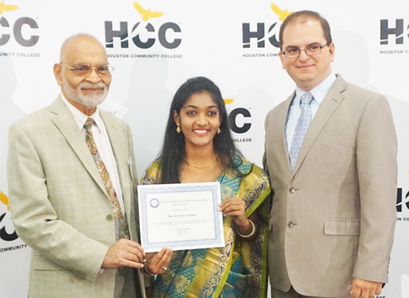 Srividya Jindam (center) holds the FIS mentorship certificate presented by FIS Chairman Krishna Vavilala (left) and HCC Program Coordinator, Lorin Banja. Photo: Aiu Hiasyah