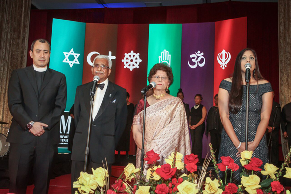Swatantra Jain, Dr. Sushma Mahajan and Dr. Sippi Khurana on stage reciting passsages from their faiths.