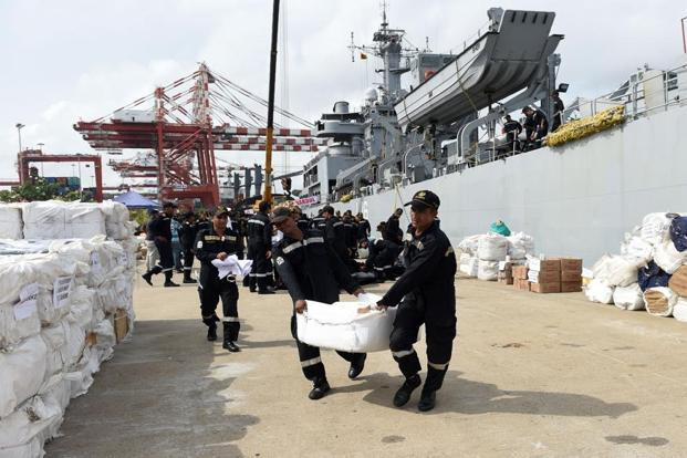 Indian Navy troops offload emergency supplies from INS Shardul at Colombo harbour in Sri Lanka on Sunday. Photo: Ishara S. Kodikara/AFP