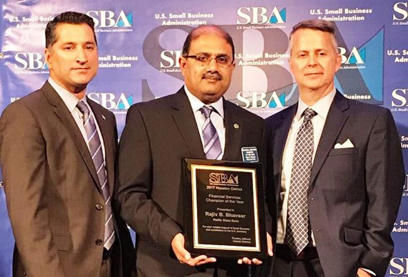From left: Asif Dakri, CEO of Wallis State Bank; Rajiv Bhavsar, Sr. VP Commercial Lending Officer at WSB; and Timothy D. Jeffcoat, SBA District Director, Houston.