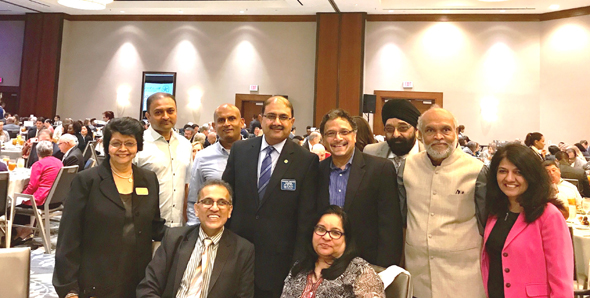 Rajiv Bhavsar with directors of the India Culture Center, of which he has twice been the president. From left: Parul Fernades, Manoj Patel, Bharat Desai, Swapan Dhairyawan, Rajiv Bhavsar, Nisha Mirani, Charlie Patel, Ajit Patel and Manisha Gandhi. IACCGH Executive Director Jagdip Ahluwalia is third from right.