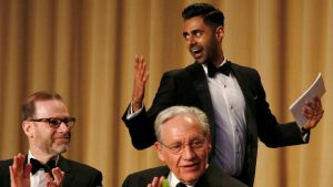 Hasan Minhaj (R) of Comedy Central walks past veteran Washington Post journalist Bob Woodward (C) and Reuters Editor-in-Chief Steve Adler (L) as he takes the lectern to perform at the White House Correspondents' Association dinner in Washington.(REUTERS)