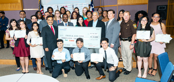 Scholarship recipients with elected officials, and IACF members Dr. Ramesh Cherivirala (scholarship committee member and former IACF president), and Dr. Vanitha Pothuri (IACF president).