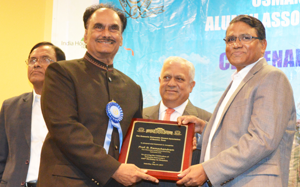 Osmania University Alumni Association of America President Harinath Medi (left) presented a plaque to OU Vice-Chancellor Dr. S. Ramachandram at the Centenary celebration at India House last Saturday, May 27.