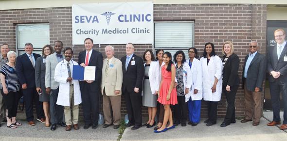 Congressman Pete Olson with Mayor Reid, leaders of Memorial Hermann and members of Seva Clinic