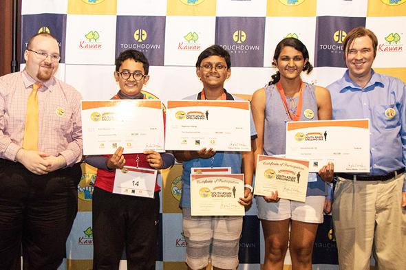From left: John Gurgarty, pronouncer; Anmol Dash (first runner up), Sravanth Malla (regional champion), Richa Juvekar (second runner up) and Garrett Hall, judge.