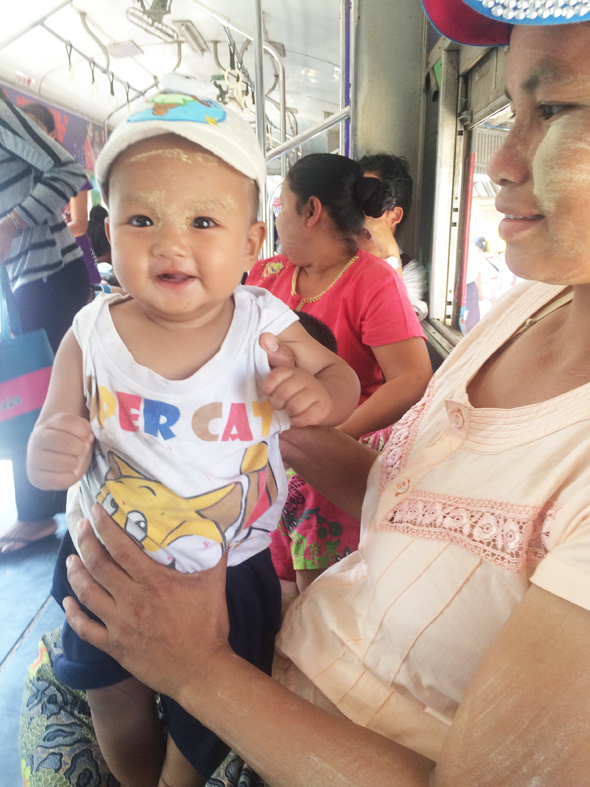 A villager with her chubby baby son on the Ring Train