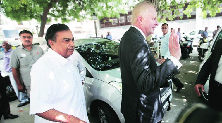 Bob Dudley (right), CEO of BP, and Mukesh Ambani, CMD of Reliance Industries, leave after meeting Petroleum Minister Dharmendra Pradhan, in New Delhi on Thursday. Reuters