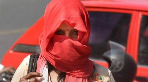 New Delhi: A woman cover herself during a hot summer day in New Delhi on Monday. PTI Photo by Atul Yadav