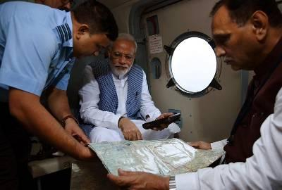 Prime Minister Narenrda Modi undertakes aerial survey in flood-affected parts of Gujarat. (Image courtesy: Twitter/@PMOIndia)