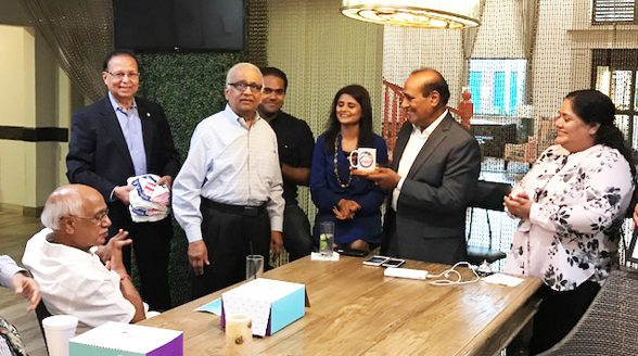 ASIE Architect Member Shashi Varia presenting an ASIE Coffee Mug and T Shirts to Dalwadi Hospitality Team for hosting the event