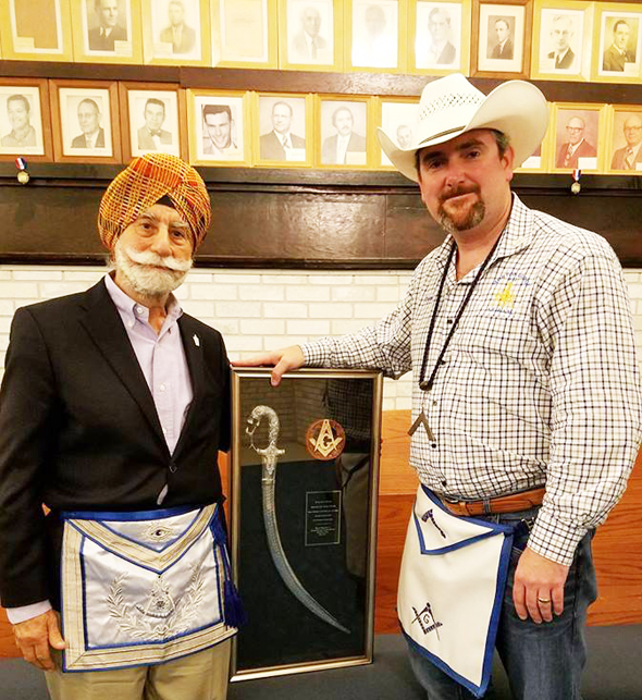The Morton Lodge No. 32 Worshipful Master Tom Cassidy presenting the award to Dr. Raj Bhalla