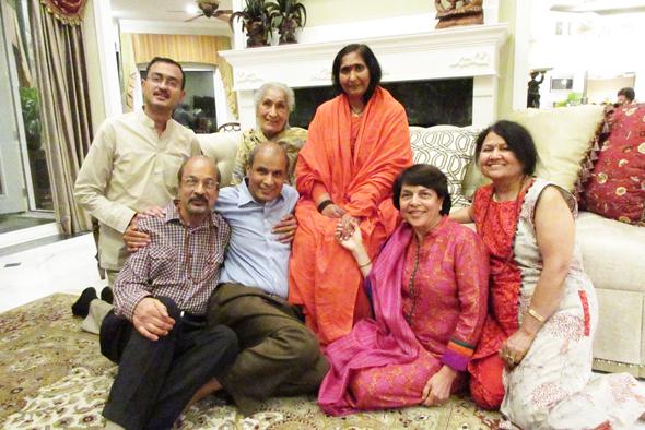 Didi Maa surrounded by the Jain family. From left, Nishant, Ravinder, Umehsh, Didi Maa, Rajni and Kamini