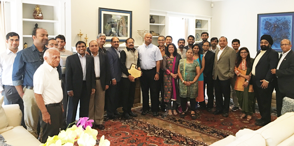 IPS officer Dr. Ramesh (center with award) poses with Consul General Anupam Ray and dignitaries from India Culture Center and Indo-American Chamber of Commercew of Greater Houston.