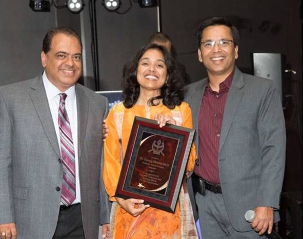 President Dr. Tarang Sharma (center) with her husband Dr. Tony Sharma (left) receiving an Appreciation Award from the incoming President Dr. Vivek Mishra