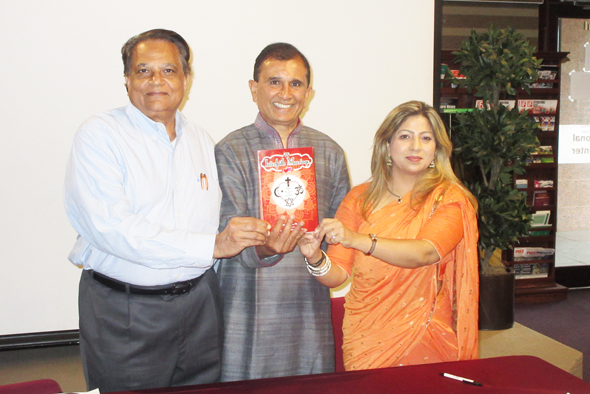 Dr. Dilip Amin (center) gave a discourse on Interfaith Marriages on Saturday, July 29 based on research which is the basis of his new book, which he held up with event coordinators Gopinath Mistry (left) and Sangeeta Dua Kataria.