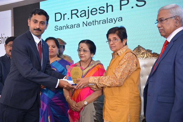Dr. Rajesh Sharma, of the Sankara Nethralaya Ophthalmic Hospital receives his award for Ophthalmology from Dr. Kiran Bedi, the Lt. Gov. of Puducherry.