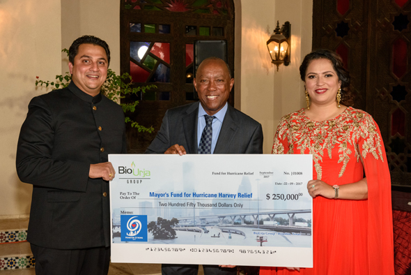 Amit and Arpita Bhandari present a check of $250,000 from BioUrja to Houston Mayor Sylvester Turner (center) toward the Mayor's Fund for Hurricane Harvey Relief. In total, the Indo-American community has made a contribution of $1.5 million toward Hurricane Harvey relief. Photo: Bijay Dixit