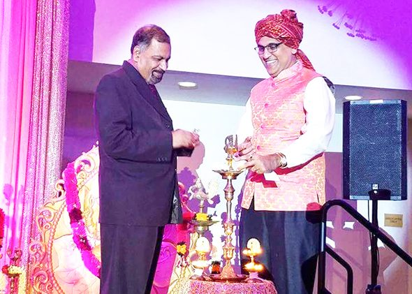 IHA National President Swapan Dhairyawan (of Houston) on the right helped to light the ceremonial lamps to start the convention.