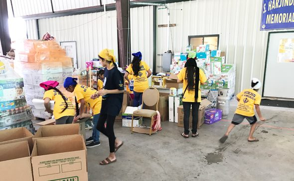 Children at SNC helping in inventory and packaging