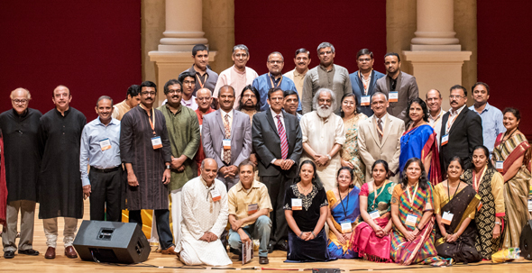 The volunteers and Board members of the Sankara Nathralaya OM Trust joined Yesudas on stage after the event. Photos: Venkat Kuttua Photography