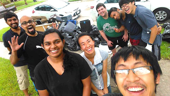 University of Houston students helping families to remove flood damaged materials out of their houses. In a selfie shot from left, Clinton Joel Noronha, Sree Sai Ram Narayana, Sarah Alexander, Lily Wu and Ryan Fung (taking the selfie) and back row from left, Alex Cardenas, Deepak Rao and Kangwook Noh.