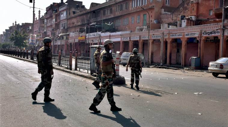 Jaipur: Security personnel patrol the streets of Jaipur as curfew imposed on Saturday after late night violence. PTI Photo(PTI9_9_2017_000162B)