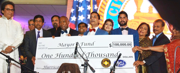 A replica of the $100,000 check was presented to Houston Mayor Sylvester Turner by Riceland CEO Tahir Javed (to Turner's right) and AAPI President Dr. Gautam Samadder, with ghazal singer and artist of the evening Talat Aziz on the left