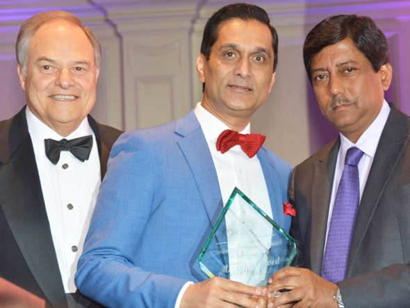The CEO and President of Riceland Healthcare, Tahir Javed, flanked by AAPI President Dr. Gautam Samadder (right) and Riceland COO Nick Lampson
