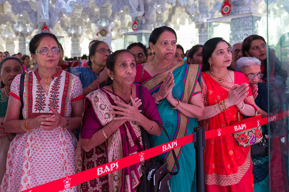 Many community members join in for the New Year Darshan.