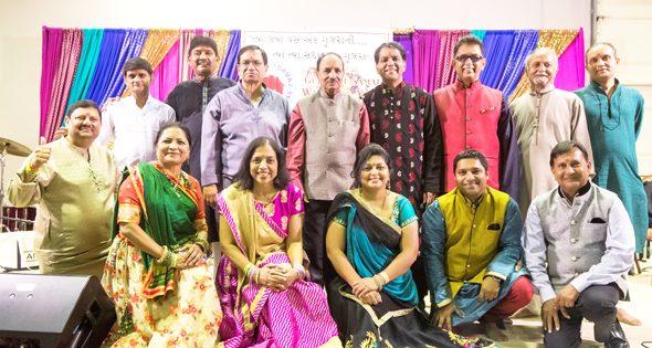 Back row (from left): Girish Naik, Prakash Desai, Devandra Patel, Bharat Parikh, Mahendra Patel, Rakesh Shah, Yogesh Patel, Kishor Patel, and Akshay Shah. Front row (from left): Geeta Patel, Meena Patel, Amee Patel, Dhruvit Shah, and Vasant Patel.