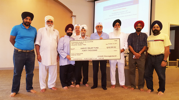 Chairman of the Board of Trustees of the Gurdwara Sahib of SW Houston, Prithvipal Singh Likhari (center with head scarf) with members of the Board and donors at the Gurdwara last Sunday, August 15 at the check donation ceremony.