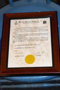 The proclamation renaming Morton Masonic Hall to Rajinder Bhalla Hall.