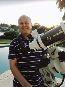 Anil Ketkar is seen with his telescope setup in the backyard of his home.