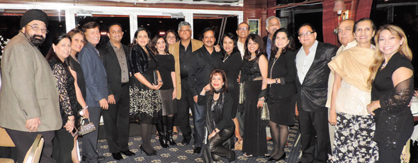Club 24 Plus members gathered on the upper deck of the dinner cruise vessel for a group photo.