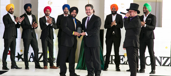 Sikh awareness fashion show, Deputy Sandeep Dhaliwal (center) being recognized by chief guests of the show, former Sheriff Adrian Garcia.
