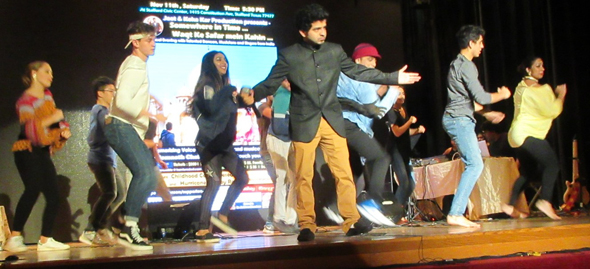 Kinjal Chatterjee performed his first number with enthusiastic student dancers and Abhishek Banerjee (in cap) backing him up. Photos: Jawahar Malhotra