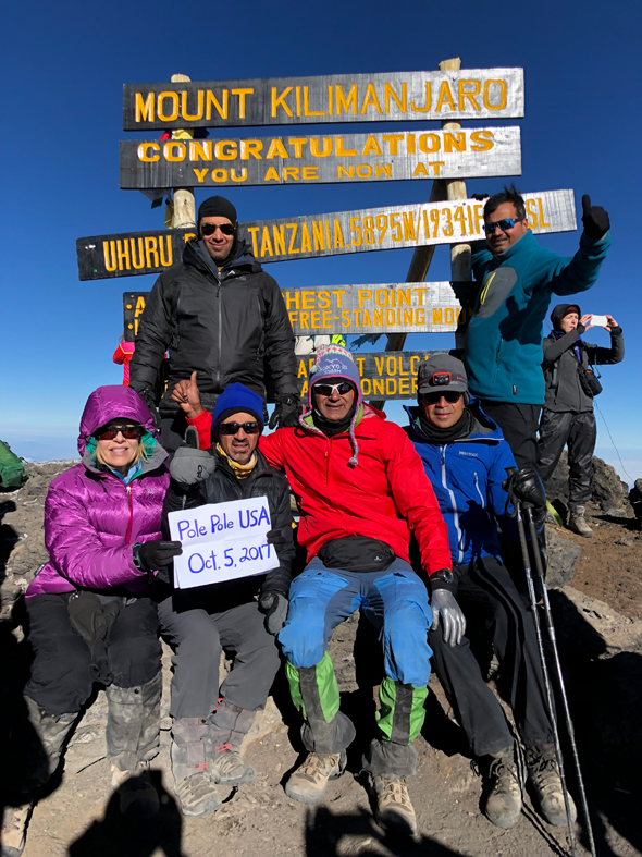 At the Summit,Uhuru peak of Kilimanjaro,19336 ft. From left: Ritesh Moza and Rakesh Shah on top; sitting,Diana Baker, Kuldip Kaul, Tej Kabra and Nadir Ali