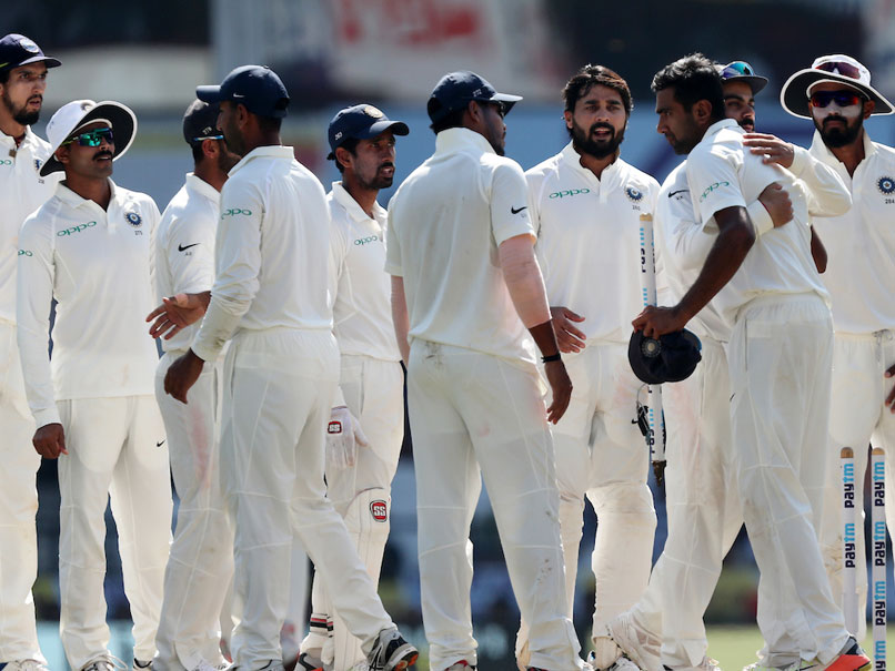 Indian players celebrate after beating Sri Lanka in the second Test.