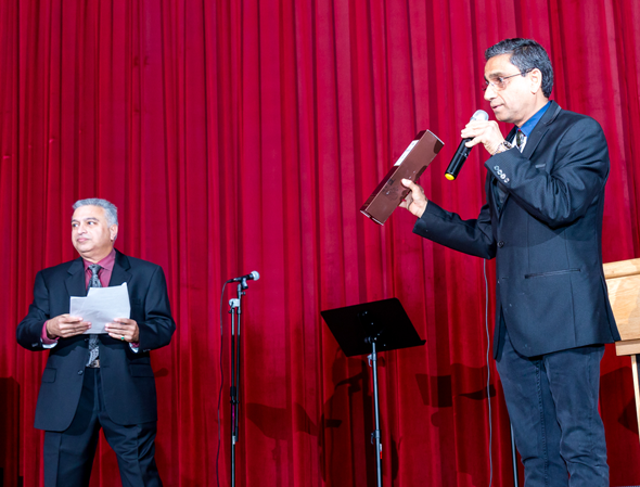 Program emcee Nozer Buchia (left) and auctioneer Subodh Bhuchar drummed up bids
