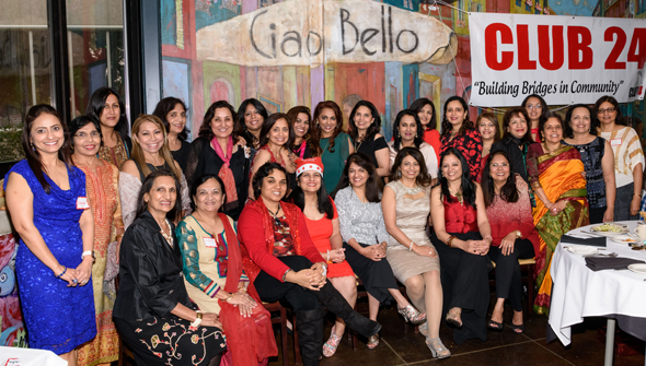 Ladies attending the Holiday Brunch gathered for a group photo (right). Photos: Bijay Dixit