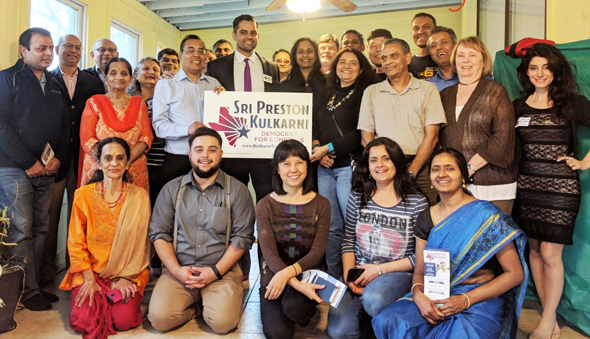 Indo-American US Congressional District 22 candidate Sri Preston Kulkarni surrounded by his supporters at a recent event.